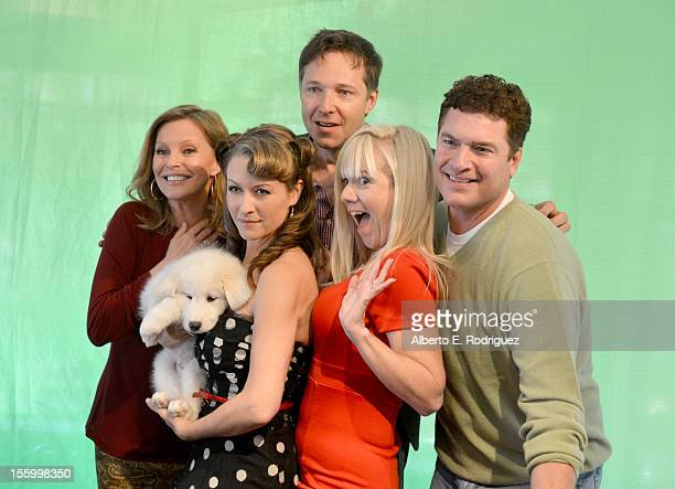 Actors Cheryl Ladd Ali Hillis George Newburn Jennifer Elise Cox and Pat Finn attend the 'Santa Paws 2 The Santa Pups' holiday party hosted by Disney...