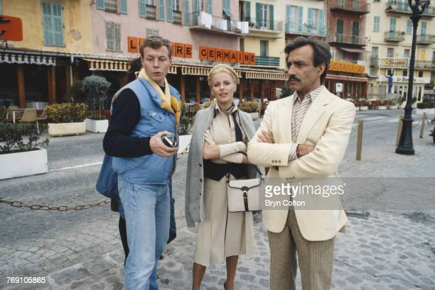 Actors Cheryl Ladd and Alejandro Rey in VillefranchesurMer France with members of the film crew during filming of Anthony Page's TV movie 'The Grace...