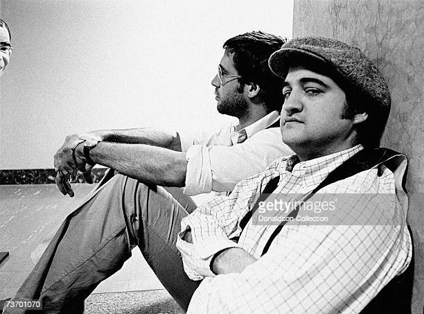 Actors Chevy Chase and John Belushi take a break in the NBC Studios in 1976 in New York