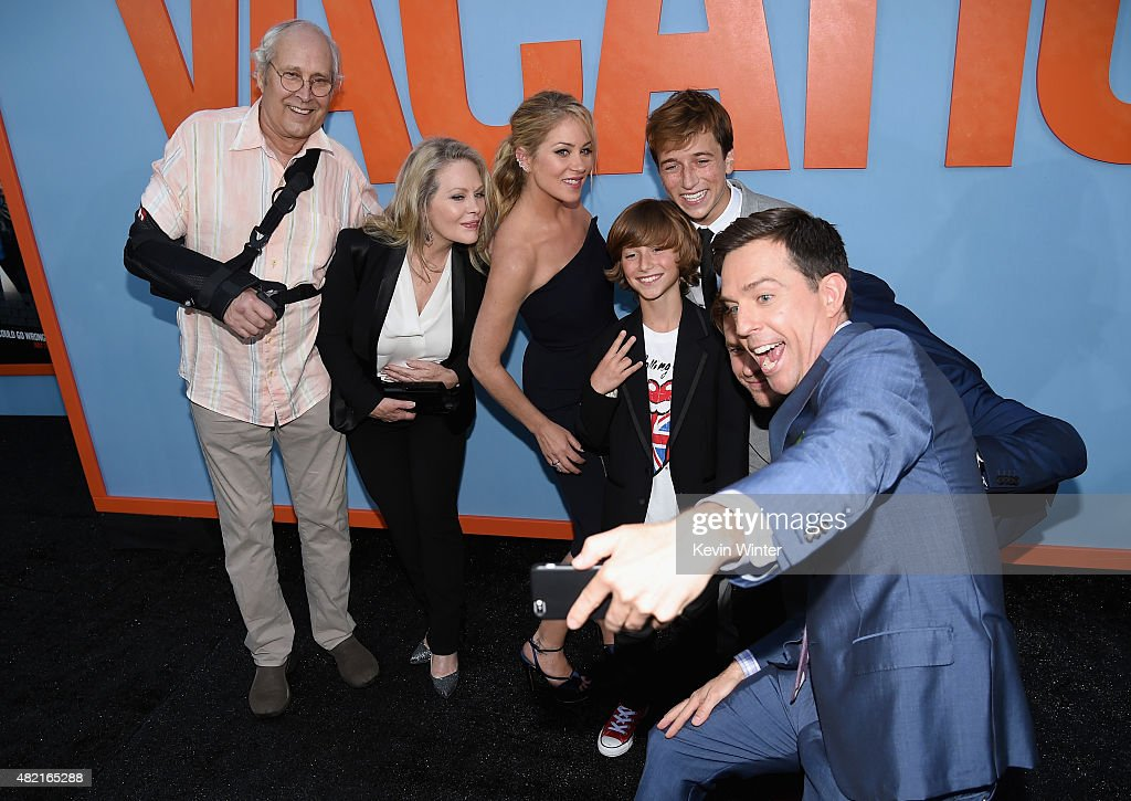 Actors Chevy Chase, Beverly D'Angelo, Christina Applegate, Steele Stebbins, Skyler Gisondo take a selfie with Ed Helms during the premiere of Warner Bros. Pictures 'Vacation' at Regency Village Theatre on July 27, 2015 in Westwood, California.