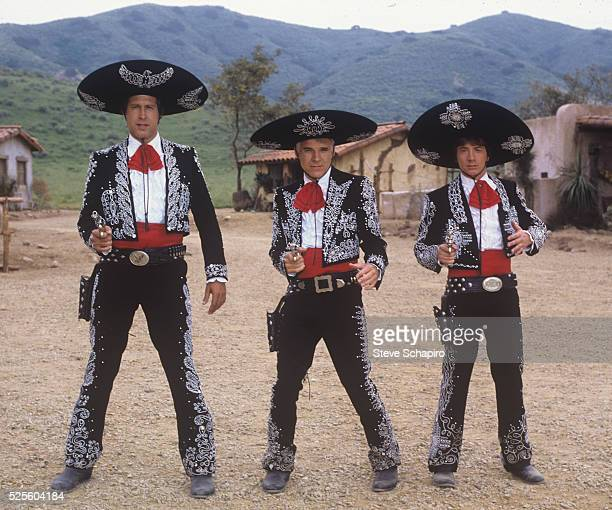Actors Chevy Chase Steve Martin and Martin Shore in costume for the film Three Amigos