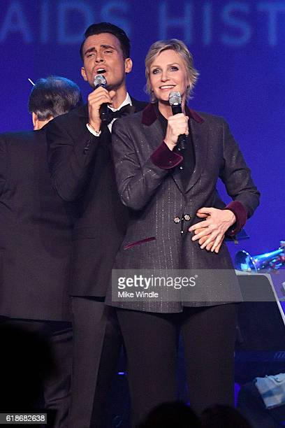 Actors Cheyenne Jackson and Jane Lynch perform onstage at amfAR's Inspiration Gala Los Angeles at Milk Studios on October 27 2016 in Hollywood...