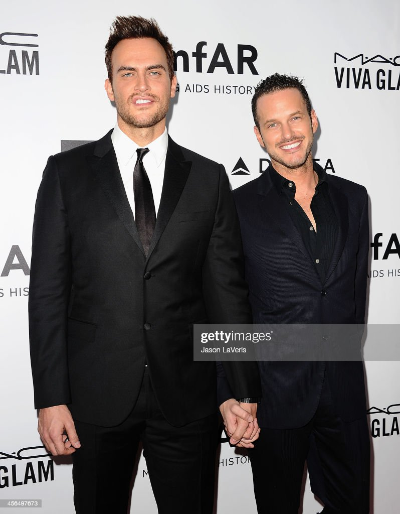Actors Cheyenne Jackson and Jason Landau attend the amfAR Inspiration Gala at Milk Studios on December 12, 2013 in Hollywood, California.