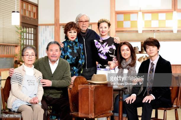 Actors Chieko Baisho Gin Maeda Ruriko Asaoka film director Yoji Yamada actors Mari Natsuki Kumiko Goto and Hidetaka Yoshioka pose for photographs...
