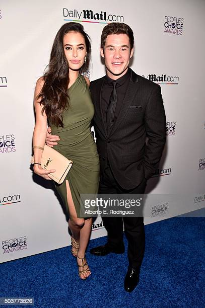 Actors Chloe Bridges and Adam DeVine attend DailyMail's after party for 2016 People's Choice Awards at Club Nokia on January 6 2016 in Los Angeles...