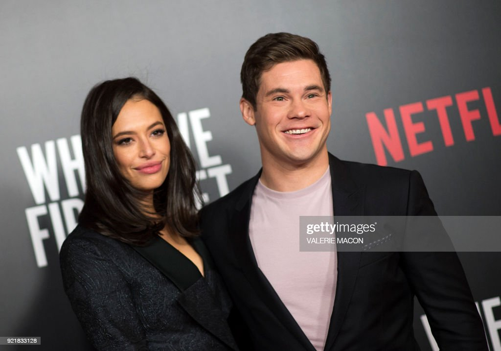 Actors Chloe Bridges (L) and Adam Devine attend the Los Angeles special screening of Netflix's 'When We First Met,' on February 20, 2018, in Hollywood, California. /