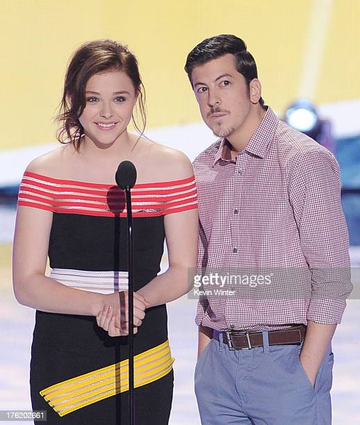 Actors Chloe Grace Moretz and Christopher MintzPlasse speak onstage during the Teen Choice Awards 2013 at Gibson Amphitheatre on August 11 2013 in...