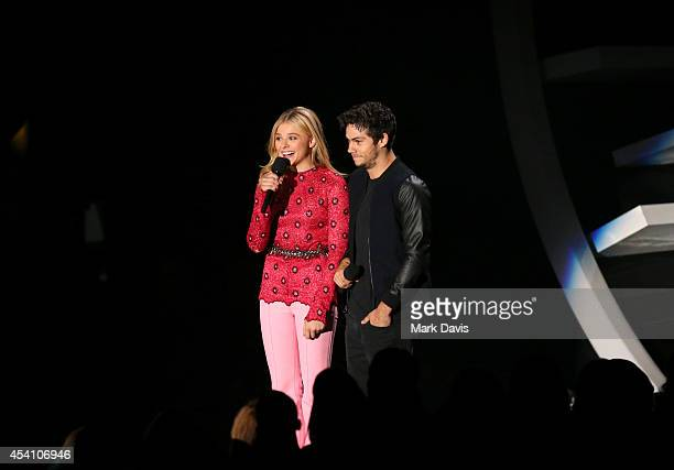 Actors Chloe Grace Moretz and Dylan O'Brien speak onstage during the 2014 MTV Video Music Awards at The Forum on August 24 2014 in Inglewood...