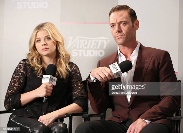 Actors Chloe Grace Moretz and Marton Csokas attend day 2 of the Variety Studio presented by Moroccanoil at Holt Renfrew during the 2014 Toronto...