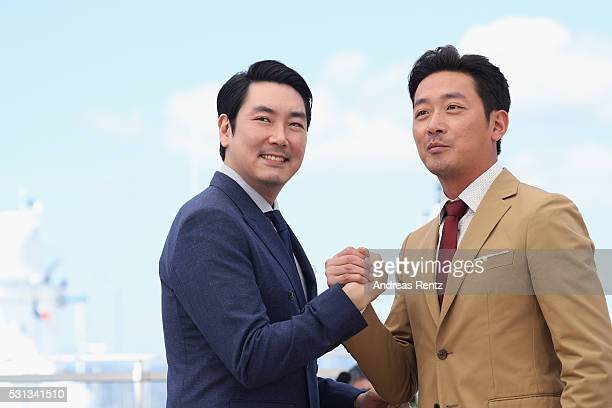 Actors Cho JinWoong and Ha JungWoo attend The Handmaiden photocall during the 69th annual Cannes Film Festival at the Palais des Festivals on May 14...
