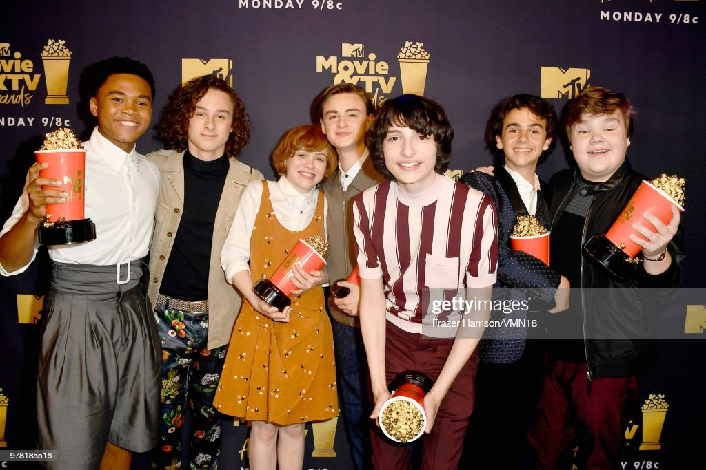 Actors Chosen Jacobs, Wyatt Oleff, Sophia Lillis, Jaeden Lieberher, Finn Wolfhard, Jack Dylan Grazer and Jeremy Ray Taylor pose with the Best On-Screen Team award for 'It' during the 2018 MTV Movie And TV Awards at Barker Hangar on June 16, 2018 in Santa Monica, California.