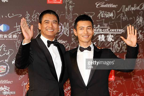 Actors Chow Yun Fat and Huang Xiaoming arrive at the red carpet during the opening ceremony for the 15th Shanghai International Film Festival at...
