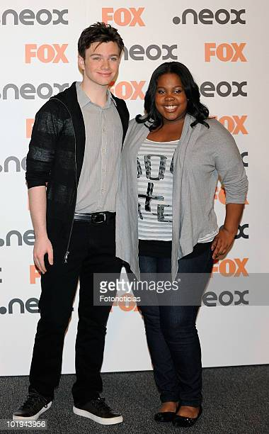 Actors Chris Colfer and Amber Riley attend a photocall for 'Glee' at the AC Palacio del Retiro Hotel on June 10 2010 in Madrid Spain
