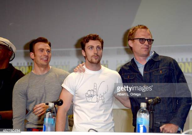 Actors Chris Evans Aaron TaylorJohnson and Paul Bettany attend the Marvel Studios panel during ComicCon International 2014 at San Diego Convention...