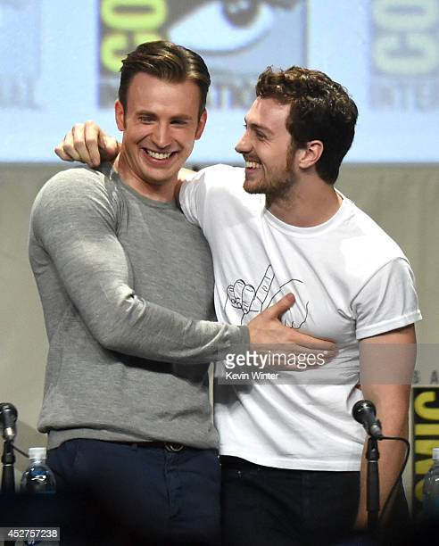 Actors Chris Evans and Aaron TaylorJohnson attend the Marvel Studios panel during ComicCon International 2014 at San Diego Convention Center on July...