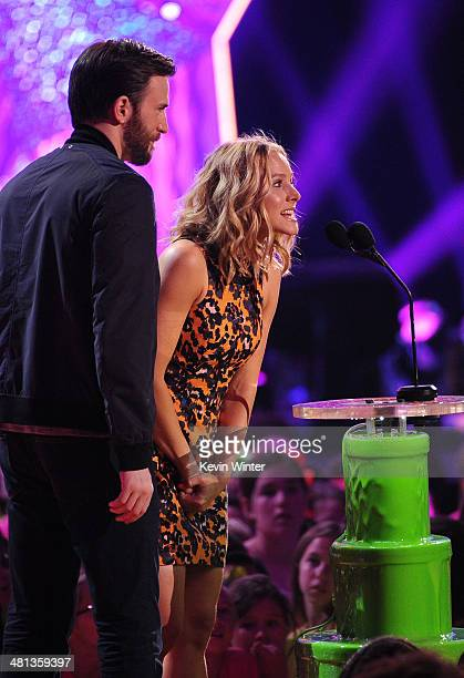 Actors Chris Evans and Kristen Bell speak onstage during Nickelodeon's 27th Annual Kids' Choice Awards held at USC Galen Center on March 29 2014 in...