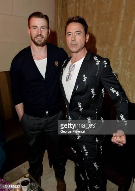 Actors Chris Evans and Robert Downey Jr attend HFPA InStyle's 2014 TIFF Celebration at the Windsor Arms Hotel on September 5 2014 in Toronto Canada