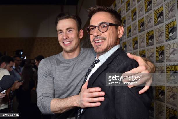 Actors Chris Evans and Robert Downey Jr attend Marvel's Hall H Press Line for AntMan and Avengers Age Of Ultron during ComicCon International 2014 at...