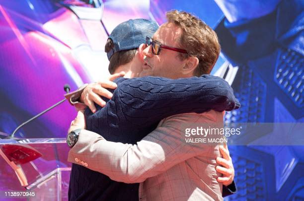 Actors Chris Evans and Robert Downey Jr attend the Marvel Studios' 'Avengers Endgame' cast place their hand prints in cement at TCL Chinese Theatre...