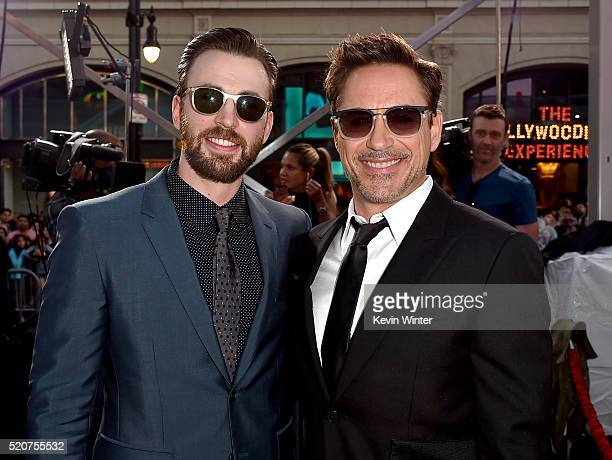 Actors Chris Evans and Robert Downey Jr attend the premiere of Marvel's 'Captain America Civil War' at Dolby Theatre on April 12 2016 in Los Angeles...