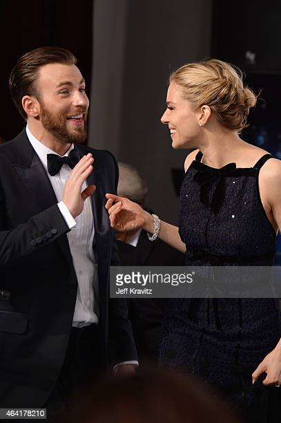 Actors Chris Evans and Sienna Miller pose in the press room during the 87th Annual Academy Awards at Loews Hollywood Hotel on February 22 2015 in...