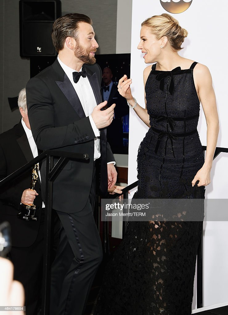 Actors Chris Evans (L) and Sienna Miller pose in the press room during the 87th Annual Academy Awards at Loews Hollywood Hotel on February 22, 2015 in Hollywood, California.