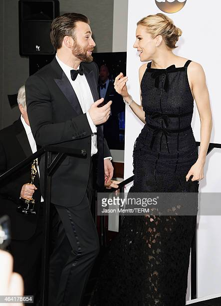 Actors Chris Evans and Sienna Miller pose in the press room during the 87th Annual Academy Awards at Loews Hollywood Hotel on February 22, 2015 in...