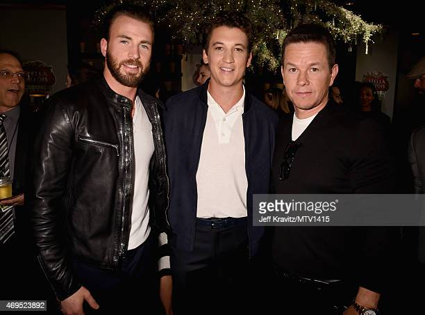 Actors Chris Evans Miles Teller and Mark Wahlberg attend The 2015 MTV Movie Awards at Nokia Theatre LA Live on April 12 2015 in Los Angeles California