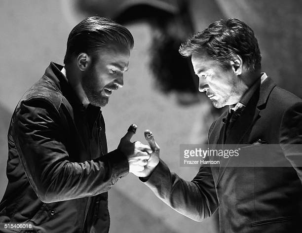 Actors Chris Evans Robert Downey Jr on stage during the Nickelodeon's 2016 Kids' Choice Awards at The Forum on March 12 2016 in Inglewood California