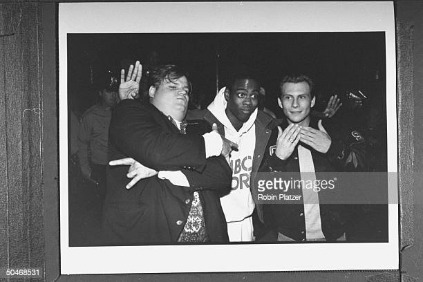 Actors Chris Farley Chris Rock Christian Slater clowning around as they arrive at the opening of the Planet Hollywood restaurant