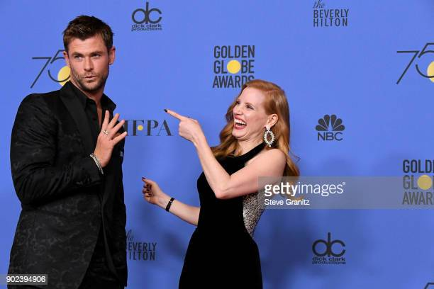 Actors Chris Hemsworth and Jessica Chastain pose in the press room during The 75th Annual Golden Globe Awards at The Beverly Hilton Hotel on January...