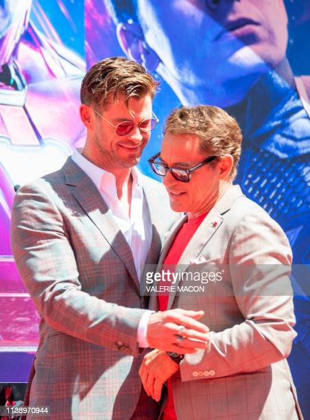 Actors Chris Hemsworth and Robert Downey Jr attend the Marvel Studios' 'Avengers Endgame' cast place their hand prints in cement at TCL Chinese...