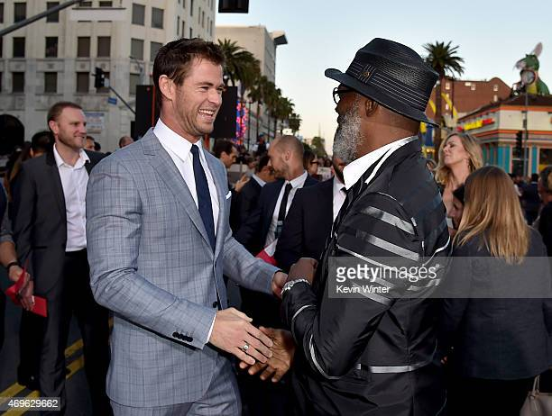 """Actors Chris Hemsworth and Samuel L. Jackson shake hands during the premiere of Marvel's """"Avengers: Age Of Ultron"""" at Dolby Theatre on April 13, 2015..."""