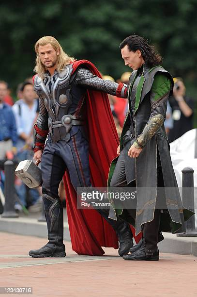 Actors Chris Hemsworth and Tom Hiddleston film a scene at The Avengers movie set in Central Park on September 2 2011 in New York City