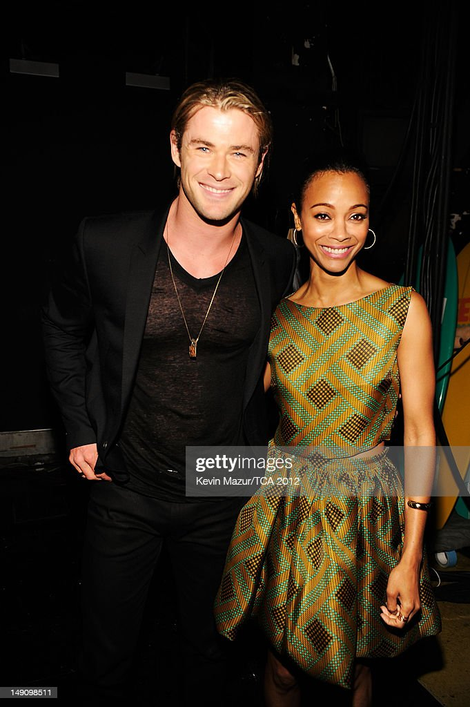 Actors Chris Hemsworth and Zoe Saldana attend the 2012 Teen Choice Awards at Gibson Amphitheatre on July 22, 2012 in Universal City, California.