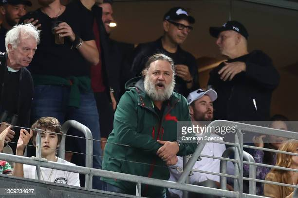 Actors Chris Hemsworth, Jeff Goldblum and Russell Crowe watch the round three NRL match between the South Sydney Rabbitohs and the Sydney Roosters at...