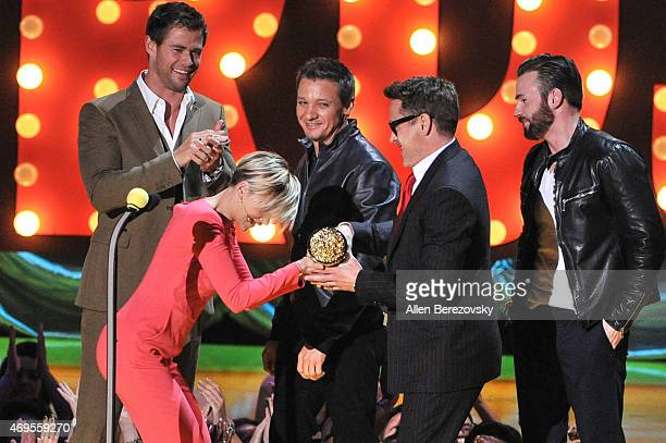 Actors Chris Hemsworth Scarlett Johansson Jeremy Renner Robert Downey Jr and Chris Evans speak onstage during The 2015 MTV Movie Awards at Nokia...
