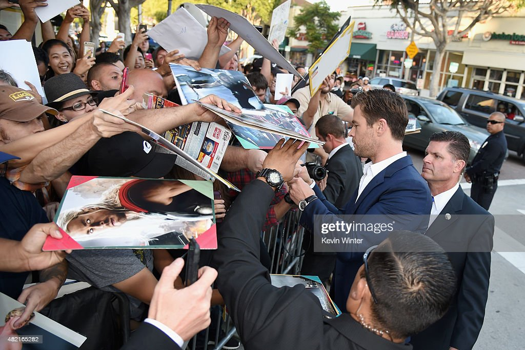 Actors Chris Hemsworth signs autographs at the premiere of Warner Bros. Pictures 'Vacation' at Regency Village Theatre on July 27, 2015 in Westwood, California.