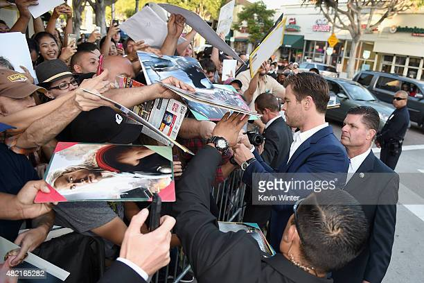 "Actors Chris Hemsworth signs autographs at the premiere of Warner Bros. Pictures ""Vacation"" at Regency Village Theatre on July 27, 2015 in Westwood,..."