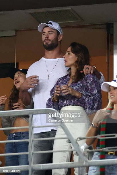 Actors Chris Hemsworth with his wife Elsa Pataky watch the round three NRL match between the South Sydney Rabbitohs and the Sydney Roosters at...