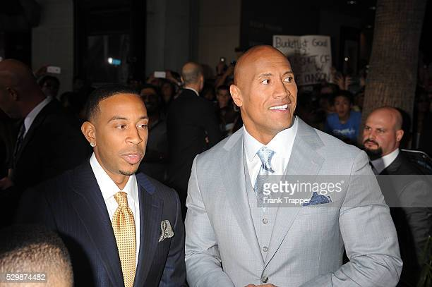 Actors Chris 'Ludacris' Bridges and Dwayne Johnson arrive at the premiere of Furious 7 held at the TCL Chinese Theater in Hollywood