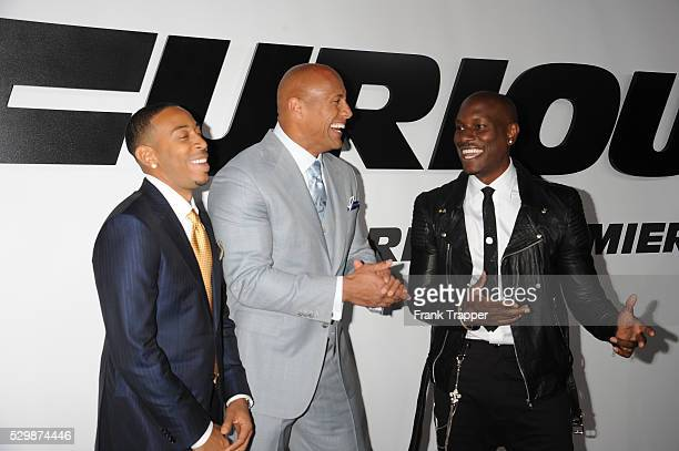Actors Chris 'Ludacris' Bridges Dwayne Johnson and Tyrese Gibson arrive at the premiere of Furious 7 held at the TCL Chinese Theater in Hollywood