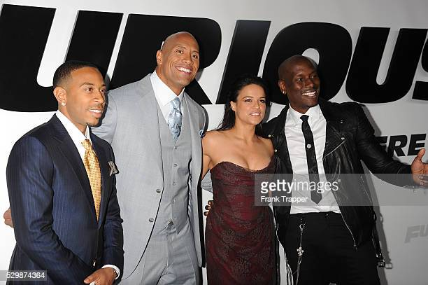 Actors Chris 'Ludacris' Bridges Dwayne Johnson Michelle Rodriguez and Tyrese Gibson arrive at the premiere of Furious 7 held at the TCL Chinese...