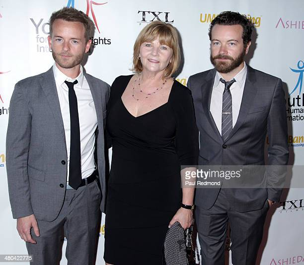 Actors Chris Masterson and Danny Masterson with their mother Carol Masterson arriving at the Youth For Human Rights International Celebrity Benefit...