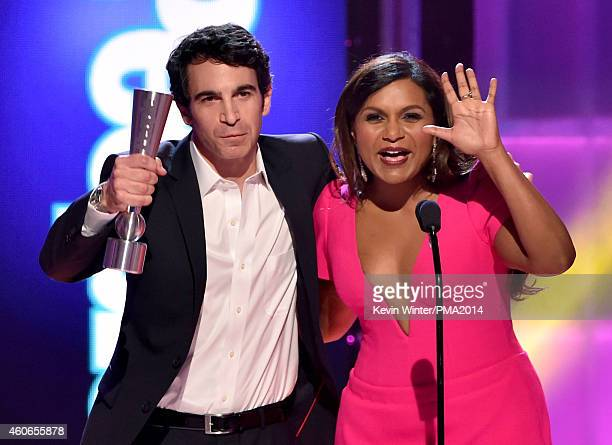 Actors Chris Messina and Mindy Kaling accept Onscreen TV Couple of the Year onstage during the PEOPLE Magazine Awards at The Beverly Hilton Hotel on...