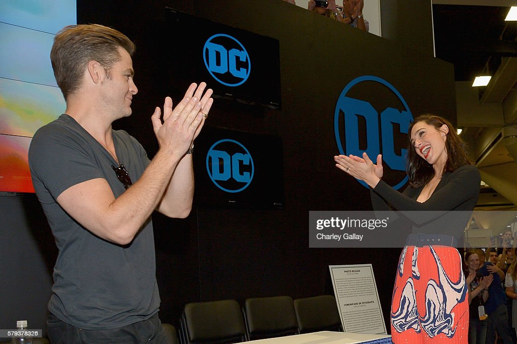 Actors Chris Pine (L) and Gal Gadot from the 2017 feature film Wonder Woman attend an autograph signing session for fans in DC's 2016 San Diego Comic-Con booth at San Diego Convention Center on July 23, 2016 in San Diego, California.