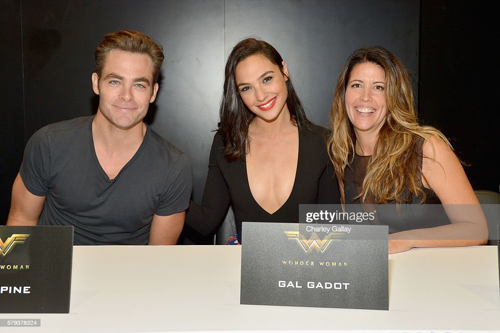 Actors Chris Pine, Gal Dagot and director Patty Jenkins from the 2017 feature film Wonder Woman attend a cast signing autograph session for fans in DC's 2016 San Diego Comic-Con booth at San Diego Convention Center on July 23, 2016 in San Diego, California.