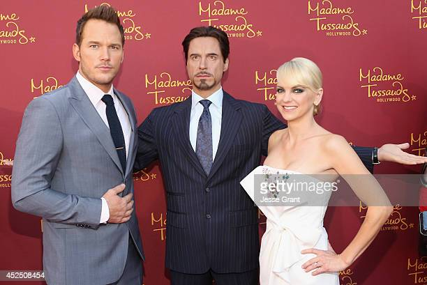 Actors Chris Pratt and Anna Faris pose alongside a Madame Tussauds Hollywood MARVEL wax figure during the Guardians of The Galaxy premiere at the...