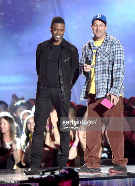 Actors Chris Rock and Adam Sandler speak onstage during the 2013 MTV Movie Awards at Sony Pictures Studios on April 14 2013 in Culver City California