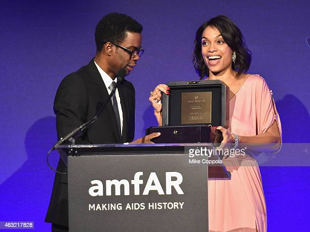 Actors Chris Rock and Rosario Dawson speak onstage at the 2015 amfAR New York Gala at Cipriani Wall Street on February 11, 2015 in New York City.